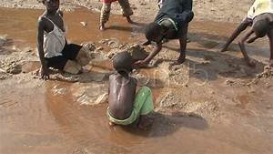 Malawi: african children play with water and sand 2 ...