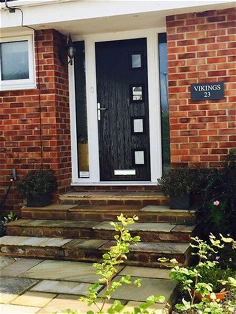 full view contemporary modern wood clad home  grey upvc double glazed windows grey doors