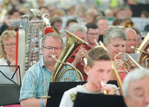 The Horn Section Plays A Tune During A Session Of The