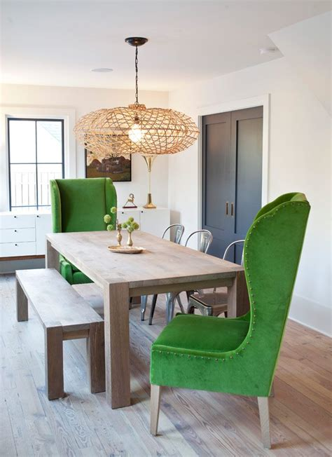 upholstered king queen chairs wood table statement pendant dining spaces dining room