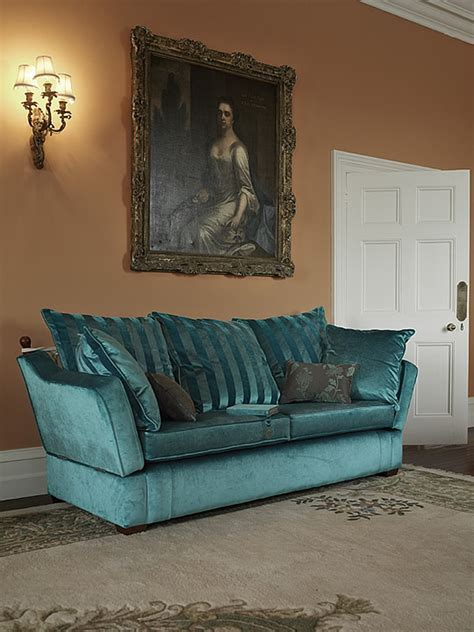 Knowle Settee by The Knowle Drop Arm Settee