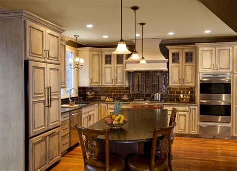 french cream antiqued painted wood cabinetry featuring