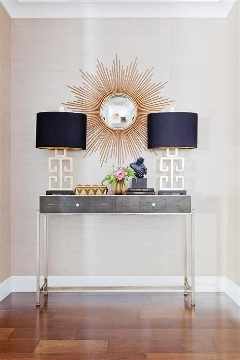entryway console table and mirror gold and gray foyer features a gold sunburst mirror over a gray console table jonathan charles