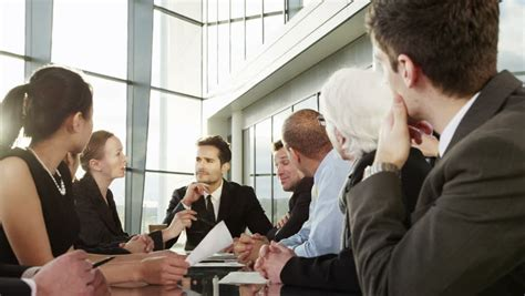 diverse business meeting cheerful diverse business in discussion in a