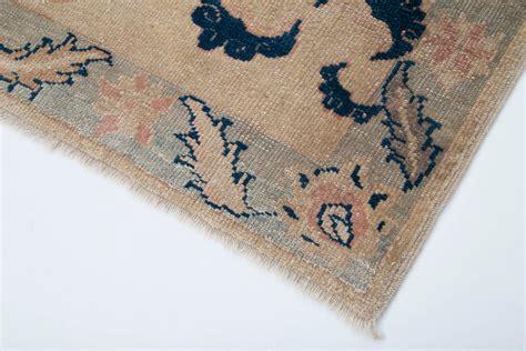 beige handmade vintage oriental small rug