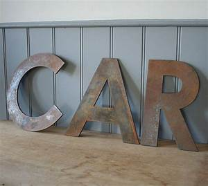 large metal letters by homestead store With large tin letters