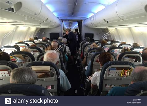 boeing 757 cabin passengers in the cabin of a thompson airways boeing 757