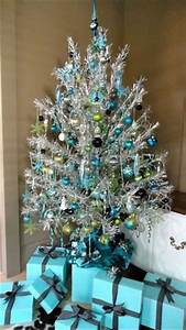 The tree is the classic vintage silver tree from the 1960s