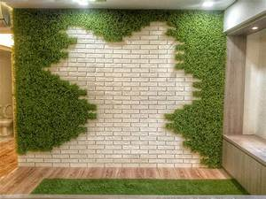 10 ways to liven up your home with artificial greenery for Interior design grass wall