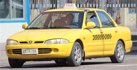 Proton Wira Taxi In Pyongyang, North Korea.jpg