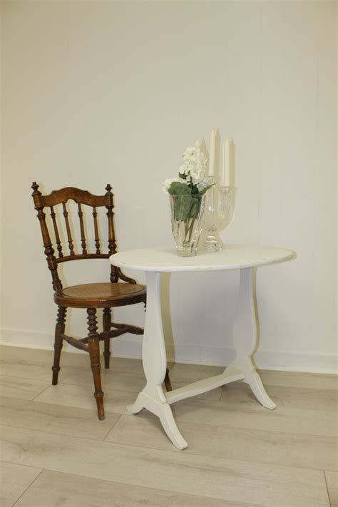 2 swedish antique wood chairs and small white drop leaf table