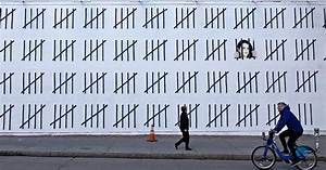 Banksy emerges in new york and calls attention to for Banksy zehra dogan nyc