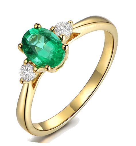 yellow engagement ring trilogy half carat oval cut emerald and engagement ring in yellow gold
