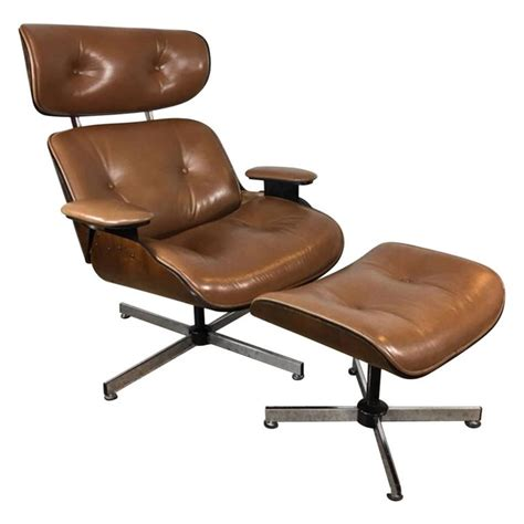 plycraft light brown leather lounge chair and ottoman at