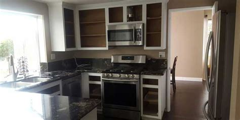 refaced kitchen cabinets how to redo kitchen cabinets without painting or priming 1800