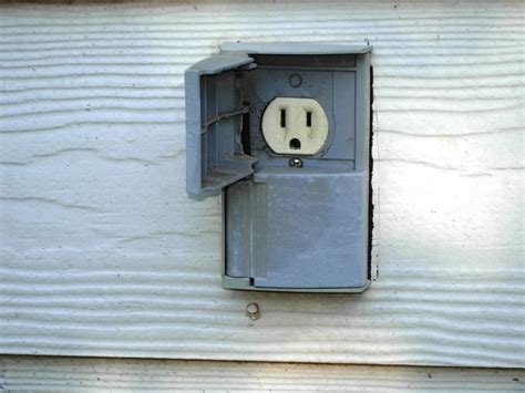 outdoor light with electrical outlet outlet handyhomeowner