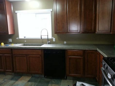 faucet placement for kitchen sink my kitchen maple cabinets concrete countertops side