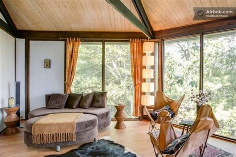 wooden yurt octagon cabin  big windows mountain