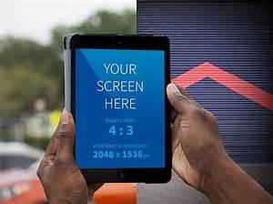 Hands holding iPad outside Mockup | MockupWorld