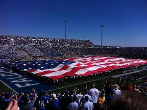 Falcon Stadium with Cadets holding the flag for the pre ...