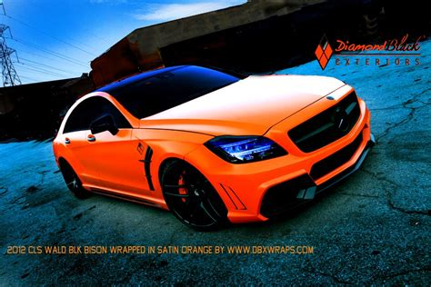 orange mercedes mercedes cls550 black bison wrapped in orange by dbx
