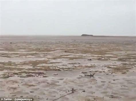 rare phenomenon sucks water  bahamas beach daily