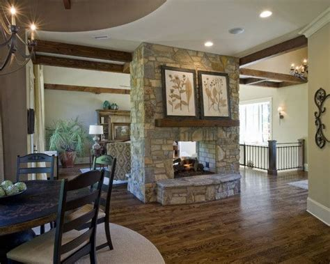 double sided fireplace separating  kitchen  living