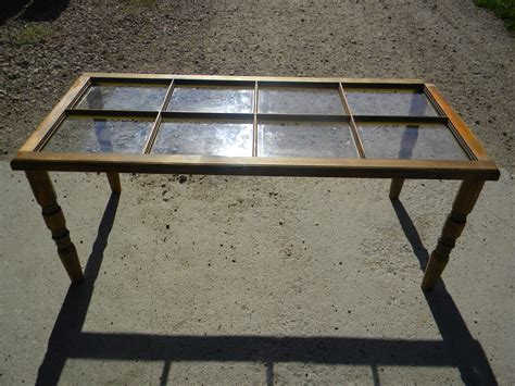 Your coffee table is so much more than a surface to kick up your feet or place a glass of wine. Ron took an old window and made a coffee table for the cabin.....rustic!!!! I do love rustic and ...