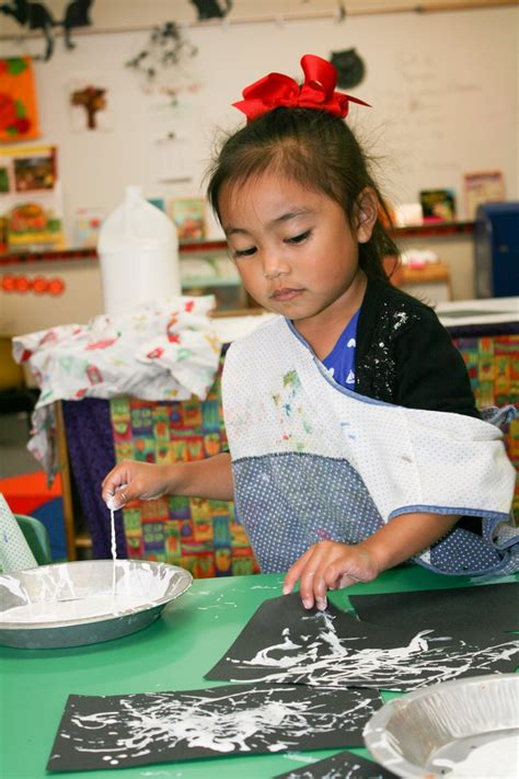 stepping preschool south kingstown ri child care 585 | 125365 child learns to work independently in art 2