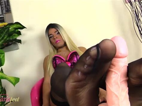 Blonde Shemale Does A Footjob With Her Feet In Black