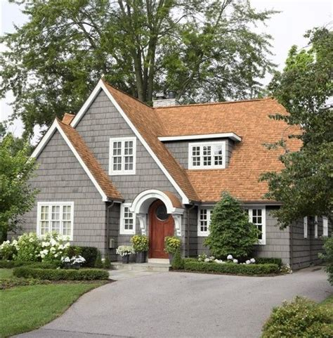 gray exterior w rust brown roof not about it but that is the color of our roof for the