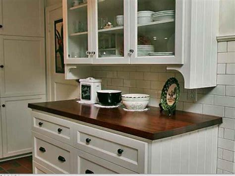 cost of cabinet refacing versus new cabinets the cost to paint kitchen cabinets professionally vs