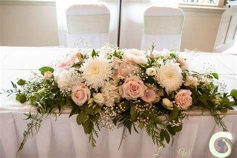 blush pink  ivory ceremony table arrangement
