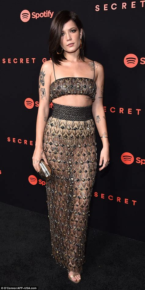 Halsey flashes her abs as she shimmers in metallic gown ...