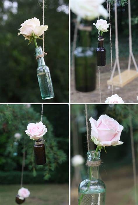 hanging bottles  trees wedding flowers wedding