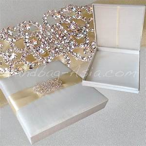 luxury ivory silk wedding box with large crystal brooch With luxury wedding invitations with crystals