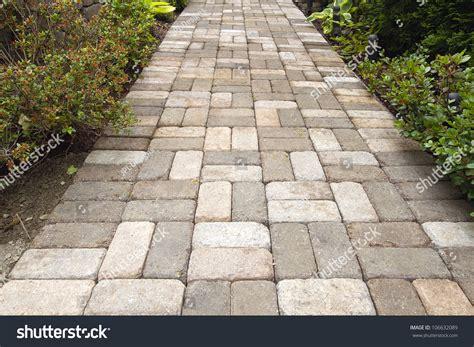 garden brick pavers path walkway basket stock photo