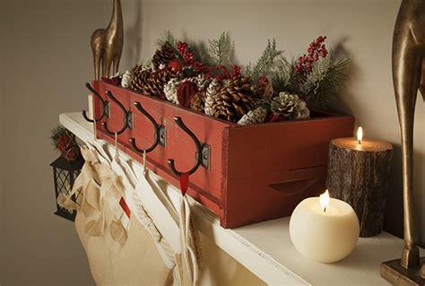 diy decor decorative stocking holder on a rustic mantel