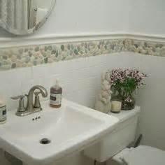 bathroom tile border ideas 1000 images about floor bathroom on pebble tiles pebble tile shower and