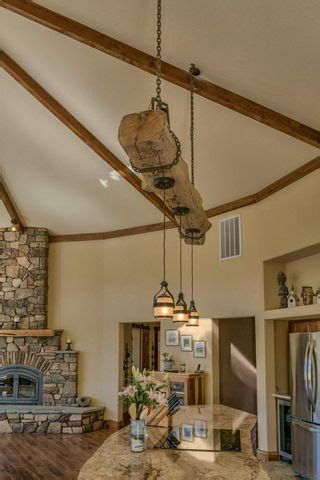 rustic reclaimed wood beam over kitchen island with
