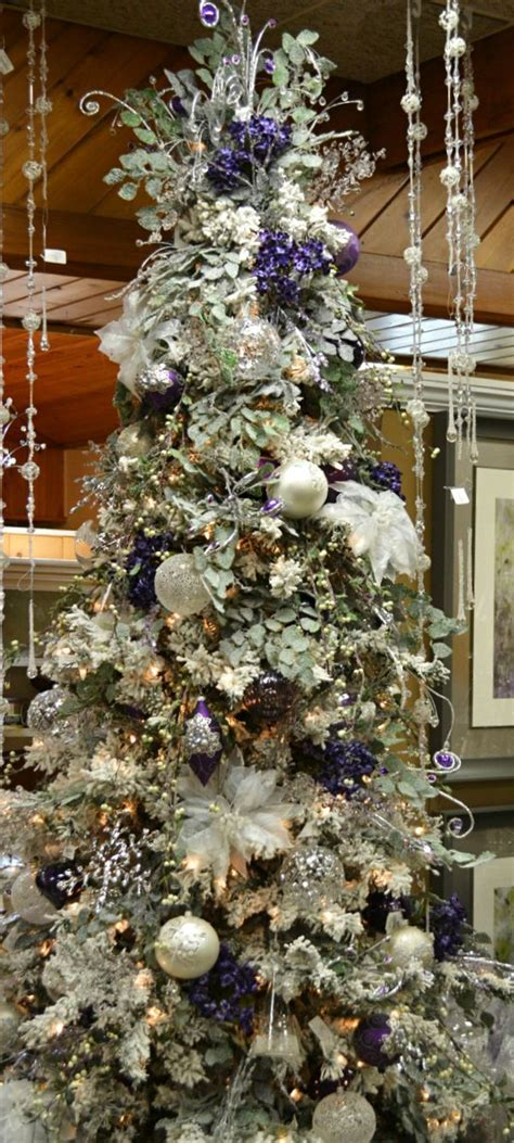 decorated frosted christmas tree christmas tree frosted purple white dancing round the tree pi