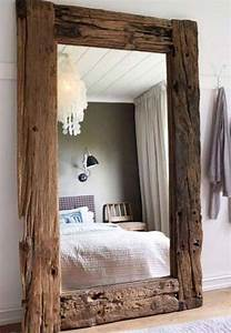 Create your own rustic mirror by framing a plain one with