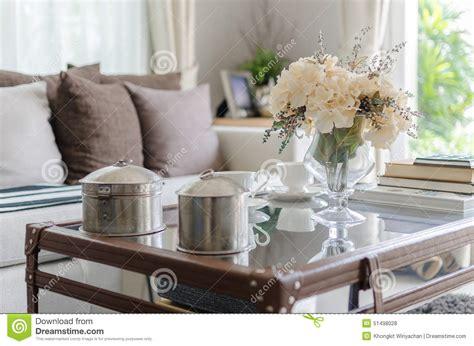 Flower Vase For Living Room by Flower In Glass Vase On Table In Living Room Stock Photo