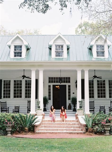southern style house plans with porches two sitting on front porch of plantation home http