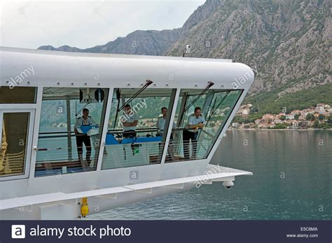 Ship Bridge by Cruise Ship Captain And Officers On Wing Bridge Awaiting