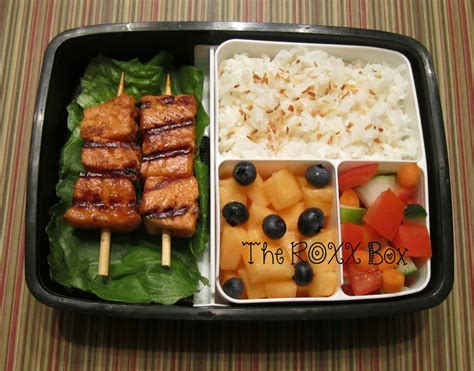 bento japanese cuisine chili paste salmon skewers with coconut rice bento