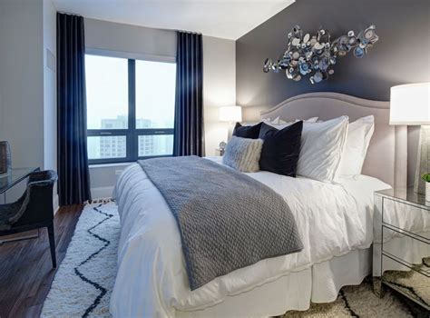 navy and grey bedroom model bedroom at amli river a luxury apartment