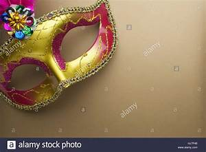 Colorful mardi gras or carnivale mask on a gold background ...