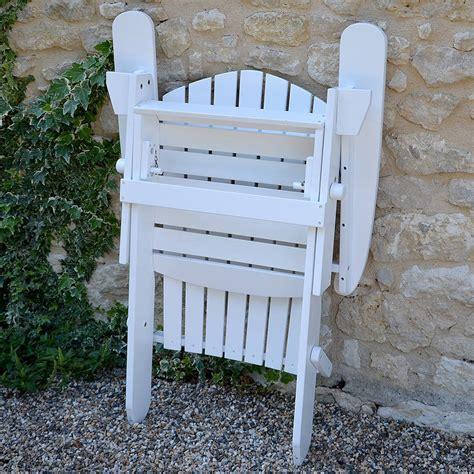 adirondack folding hardwood chair painted white by plant