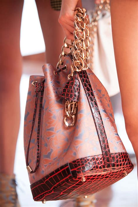dior cruise  runway bag collection featuring chain bucket bag spotted fashion